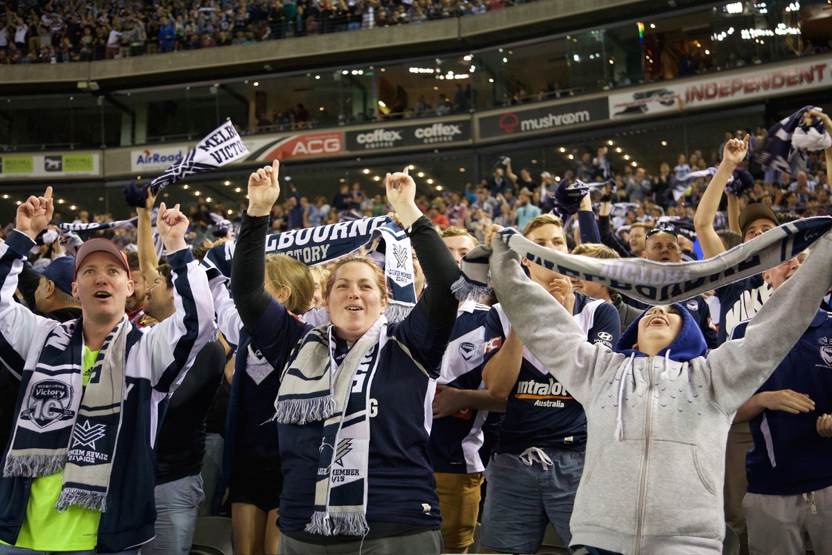 Melbourne Victory fans celebrate after their team scores a goal during round 3 of the 2014/ 2015 A-League soccer match between Melbourne City FC and Melbourne Victory at Etihad Stadium.